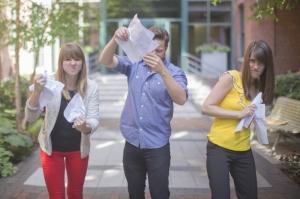 3 kids tearing paper