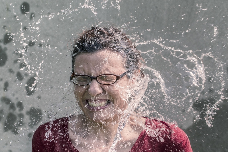 bucket of water in a lady's face